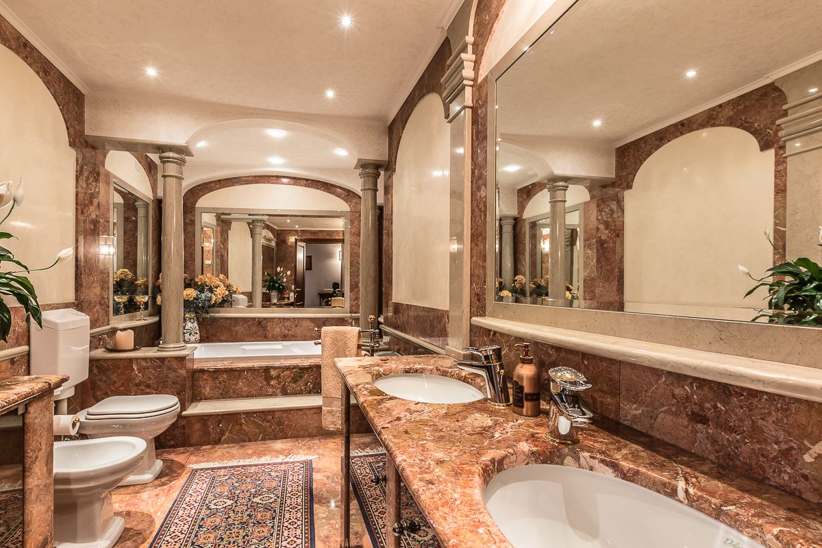 the master bathroom is simply amazing: marble flooring, walls, top, colums and spa bath