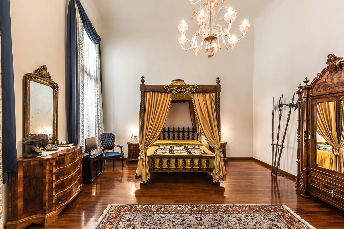 the second bedroom features an antique baldaquin and canal view