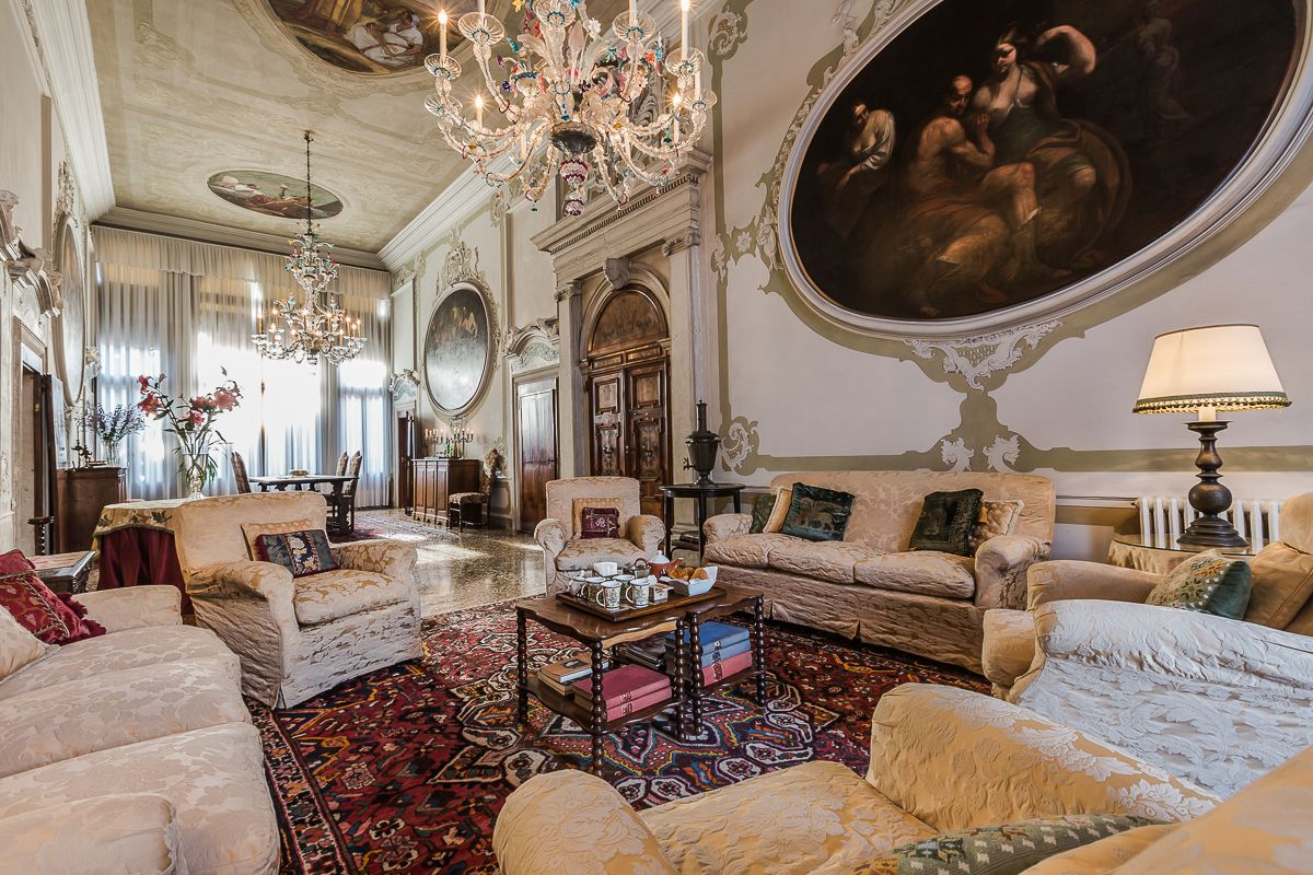 the living room features authentic 17th paintings from Paolo Pagani