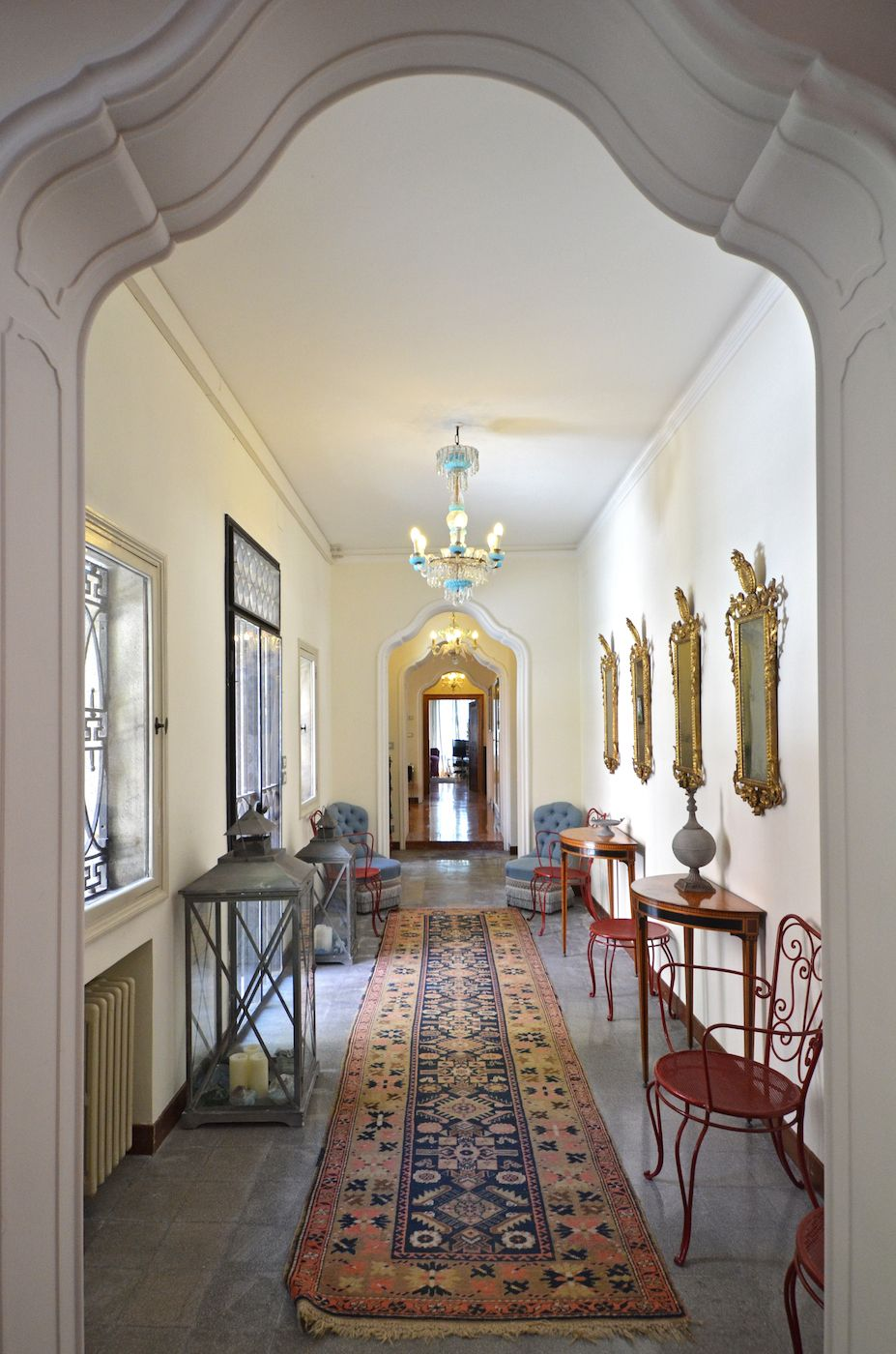 the elegant corridor that gives access to the lovely private courtyard