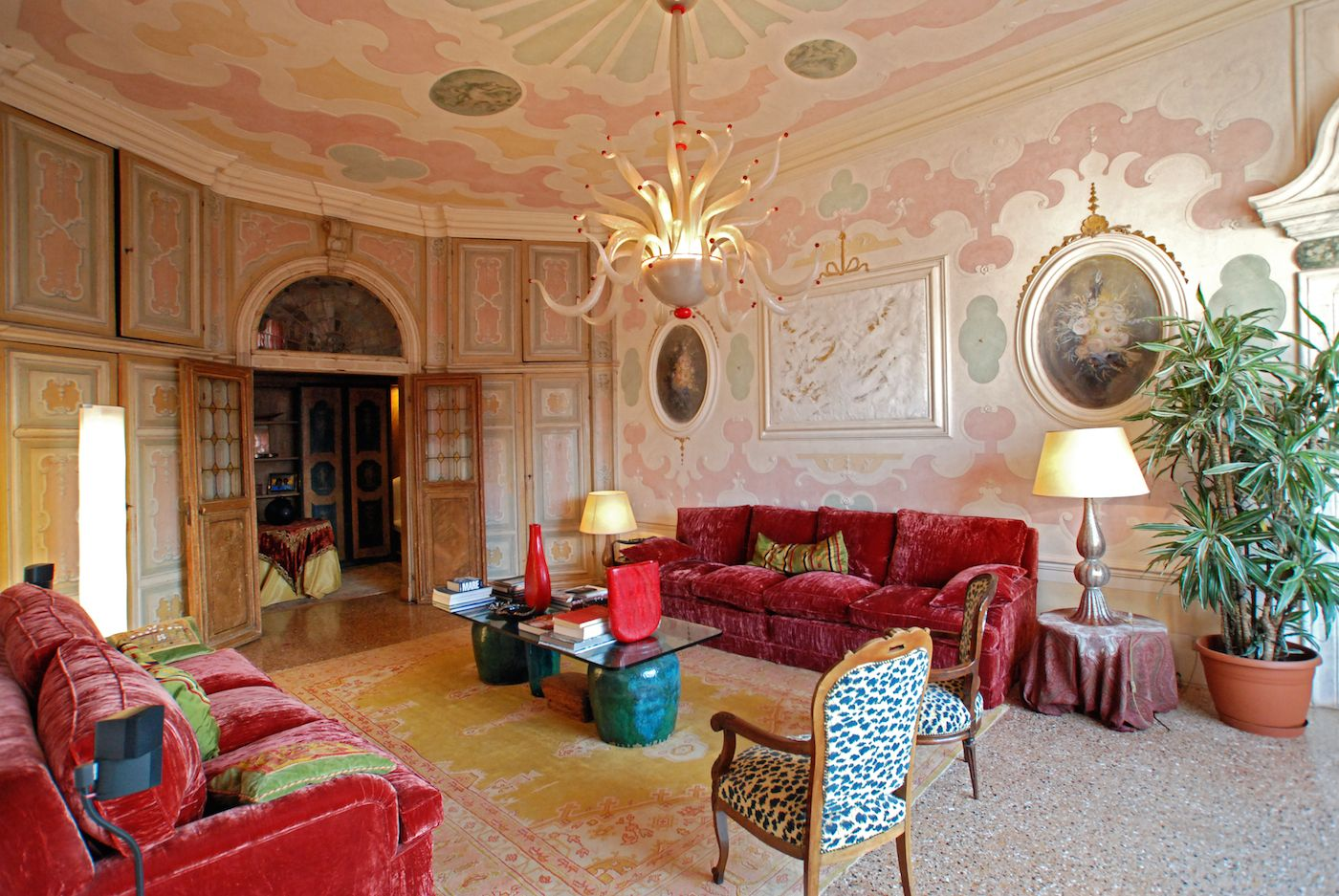 a breathtaking living room with stuuccoes and frescoes