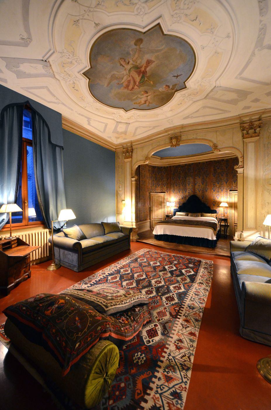 the master bedroom at night: charming, romantic and luxurious