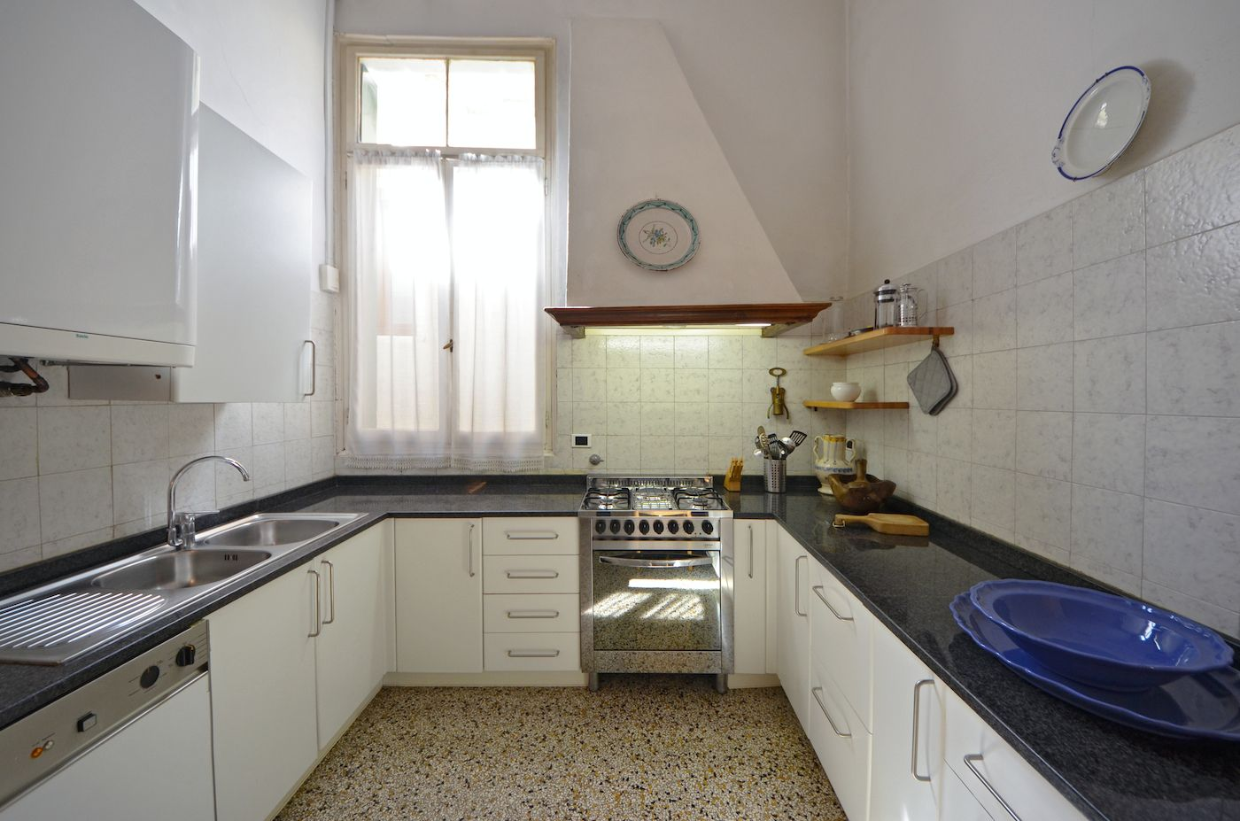 the kitchen is dated but fully functional and well equipped