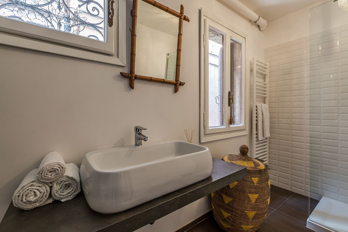 the spacious master bathroom is brand new