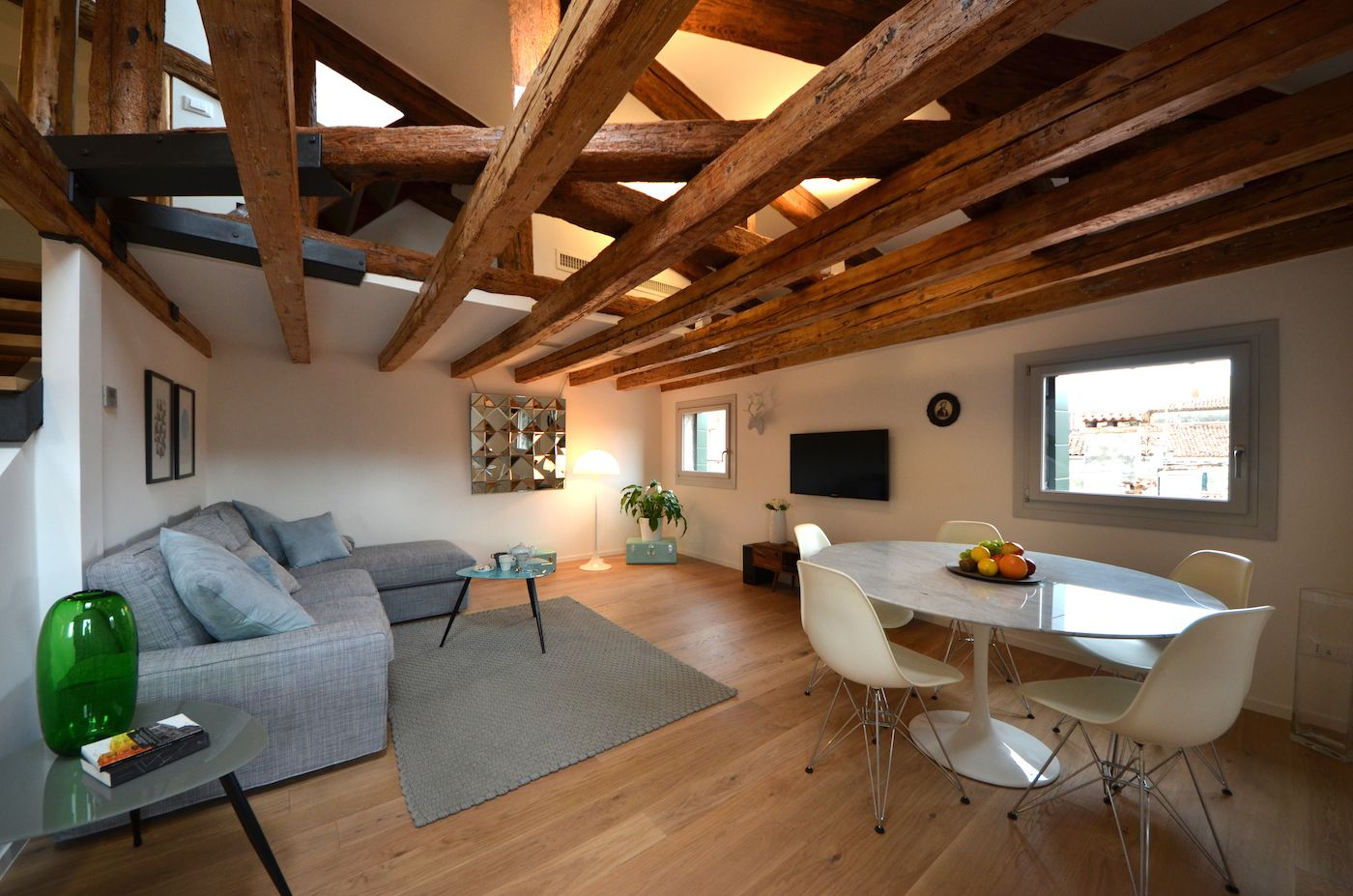 natural parquet flooring and antique wooden beamed ceiling confer warmth to the ambience