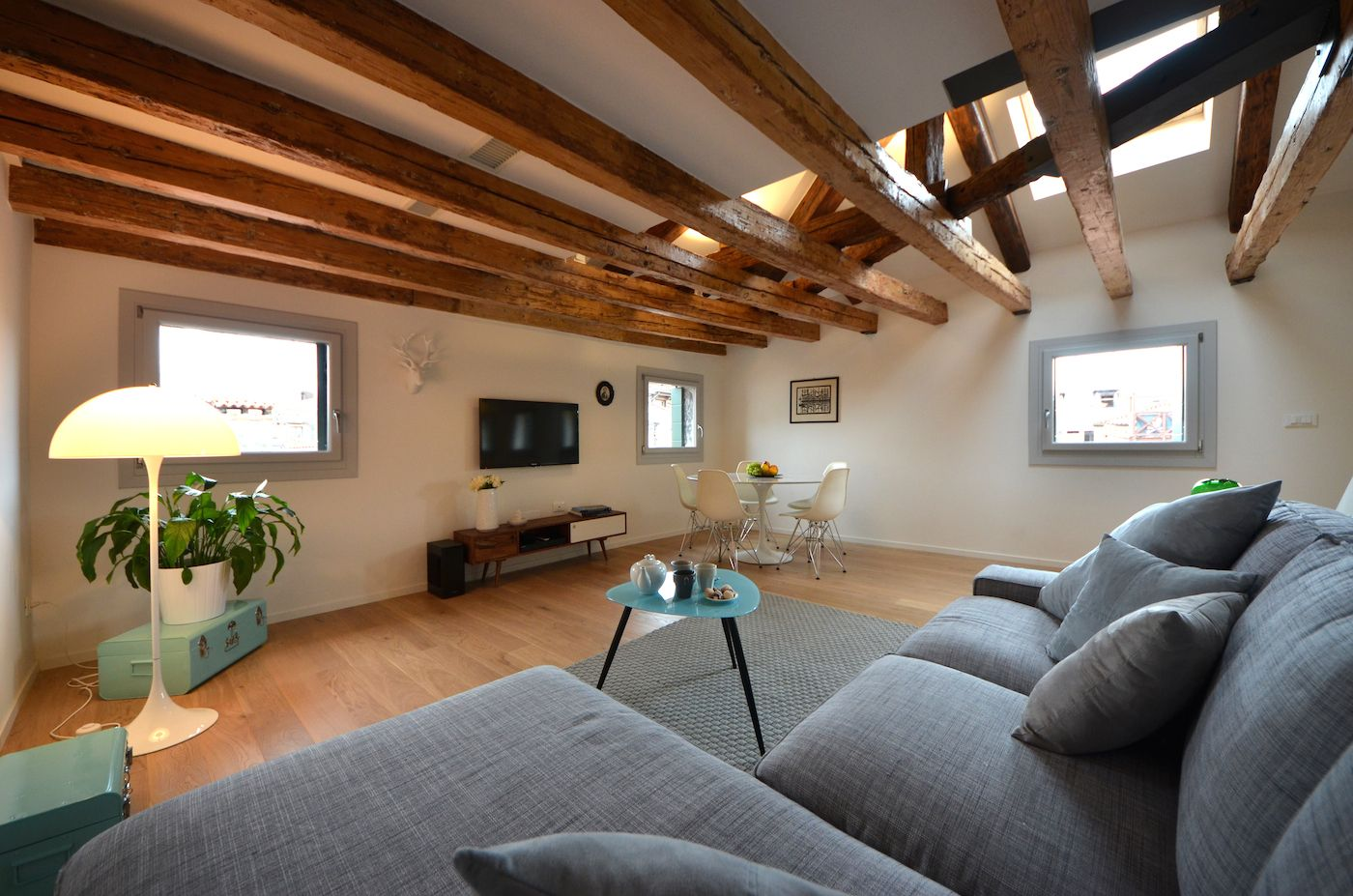 sitting on the comfortable sofa you can see the rooftops of Venice through the many windows