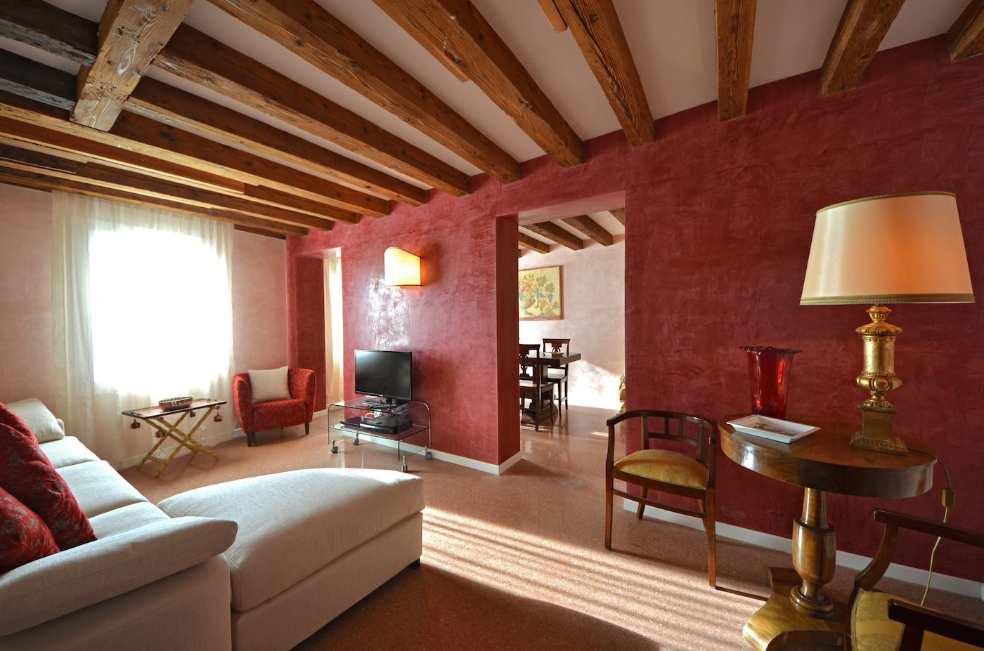 sunny living room facing Fondamenta delle Zattere and the Giudecca Canal