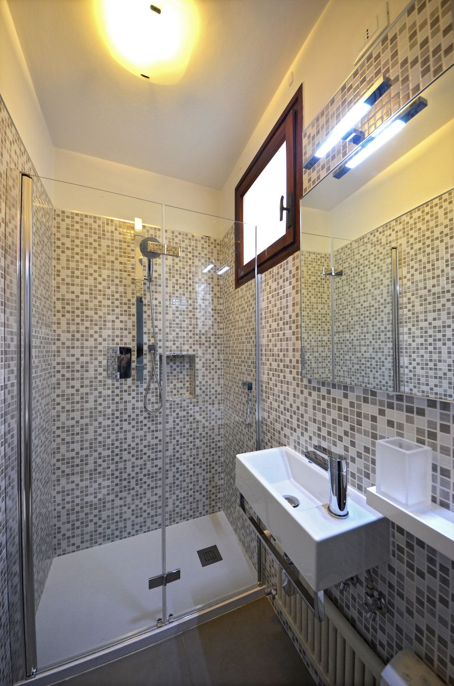 smaller second bathroom with large shower cabin
