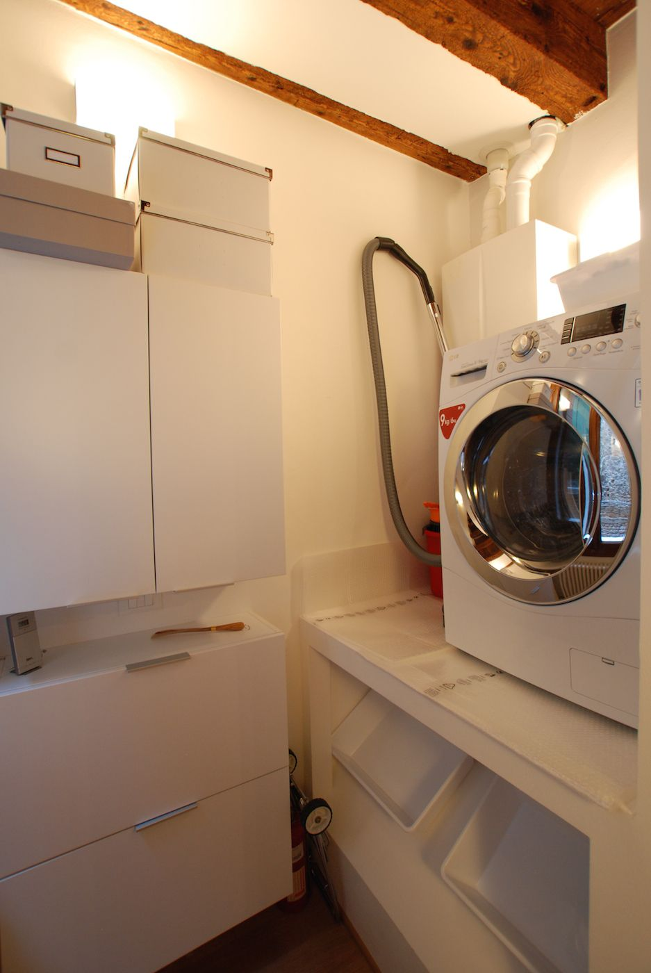 there is also a small laundry with all-in-one washer and dryer