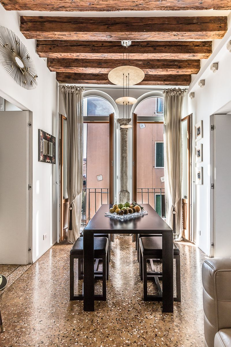 dining table with bifora and stone balcony