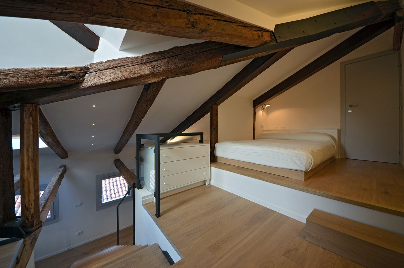 in the attic level there is a 140 cm wide bed