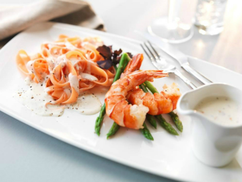 Tomato tagliatelle with butter glazed asparagus, seared langoustines