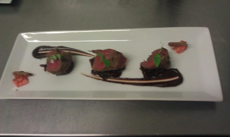 Smoked Wood Pigeon With Smoked Chocolate Sauce Red Onion Marmalade And Thai Basil
