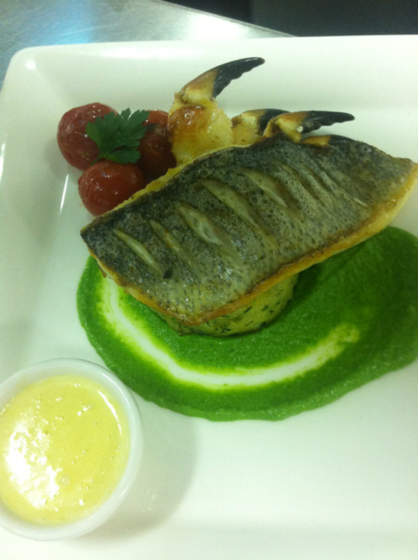 Seabass With Garlic Crab Claws Served With A Herb Potato Cake Broccoli Pur E Lemon Beurre Blanc