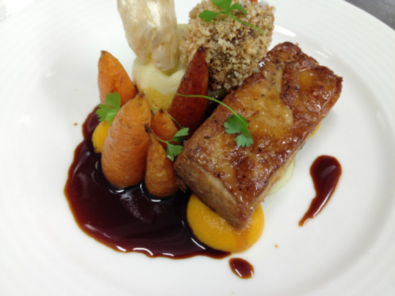 roast pork belly, puffed crackling, crispy pigs cheek & cardamon roasted carrots