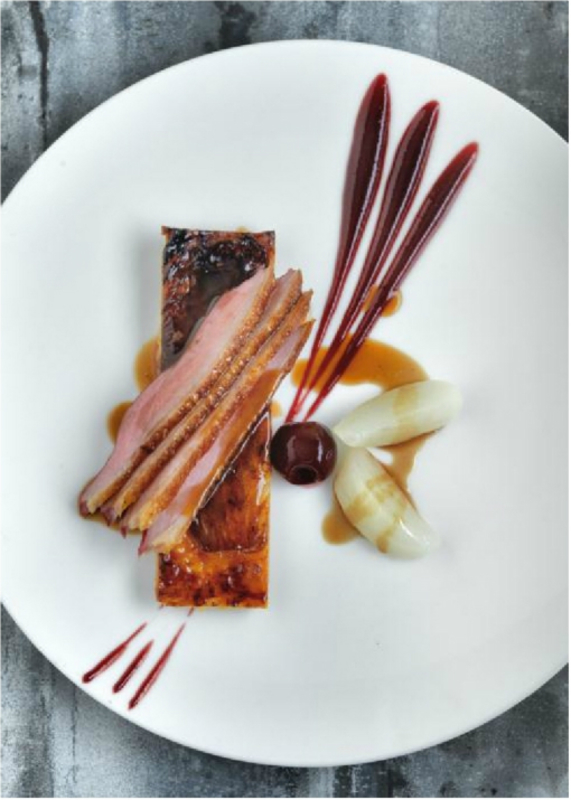 Breast of duck with a tarte fine of caramelised endive and cherry puree by Phil Howard, co owner, Elystan Street in association with Nespresso