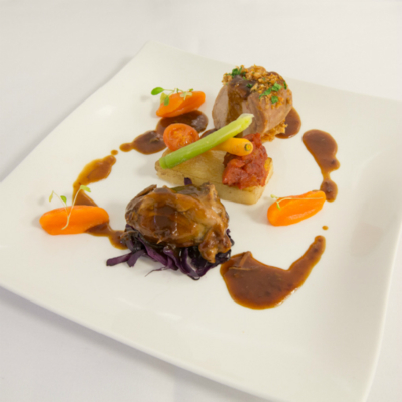 Rose farm pork fillet served with braised pigs cheeks and Cheshire cider sauce