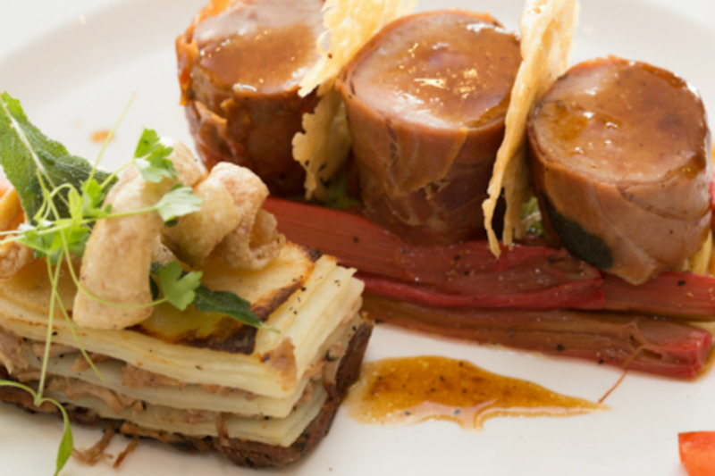 Roasted loin of Cheshire Pork, Pulled Pork Guiltte, served on Pickled Rhubarb with a Parmesan Tuile, Crackling and Pork Jus