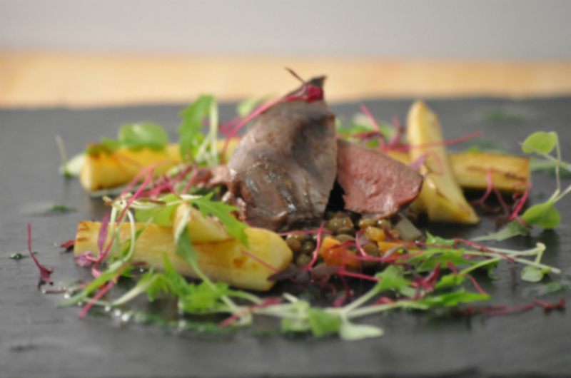 Pan roast pigeon breast with puy lentils, parsnip chips and watercress emulsion