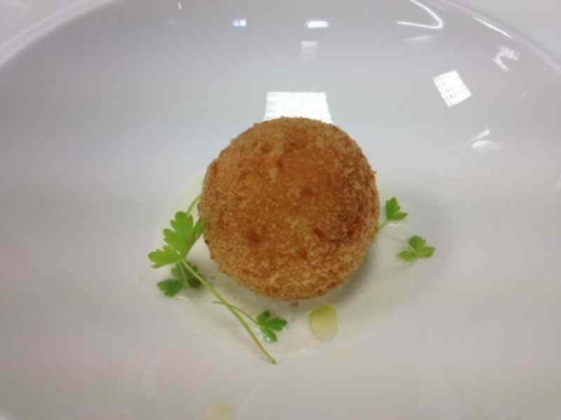 Sous vide egg yolk croquette with truffle and gruyere cheese foam