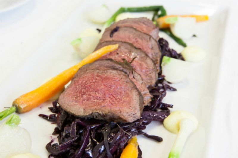 Pan Roast Loin of Roe Buck Venison, with Spiced Braised Red Cabbage, Parsnip Puree, Spring Baby vegetables and a orange and juniper Jus