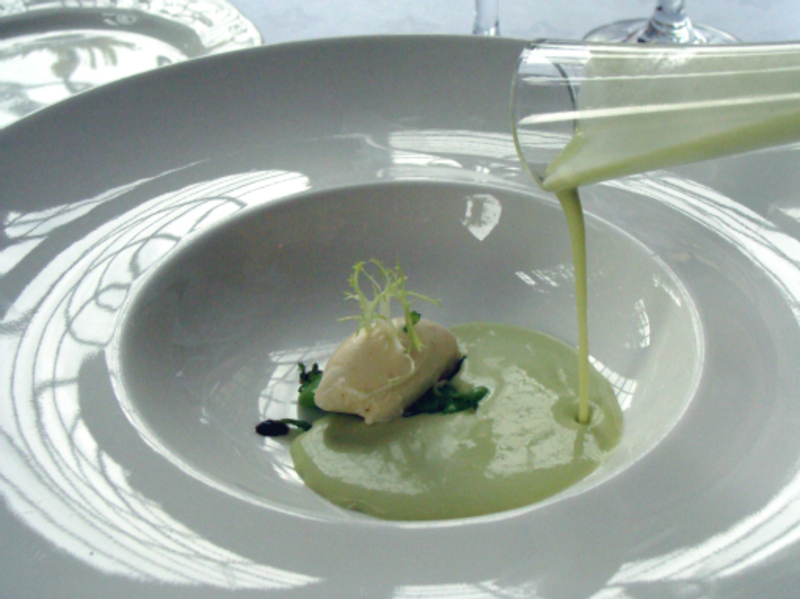 Chilled broad bean soup with black olive puree and goats'' cheese
