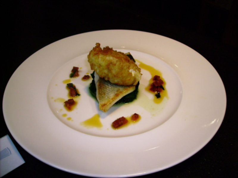 Fillet of Sea Bass Fritter of Sweetcorn & Feta Cheese Risotto Rice, Tomato & Chorizo Vierge