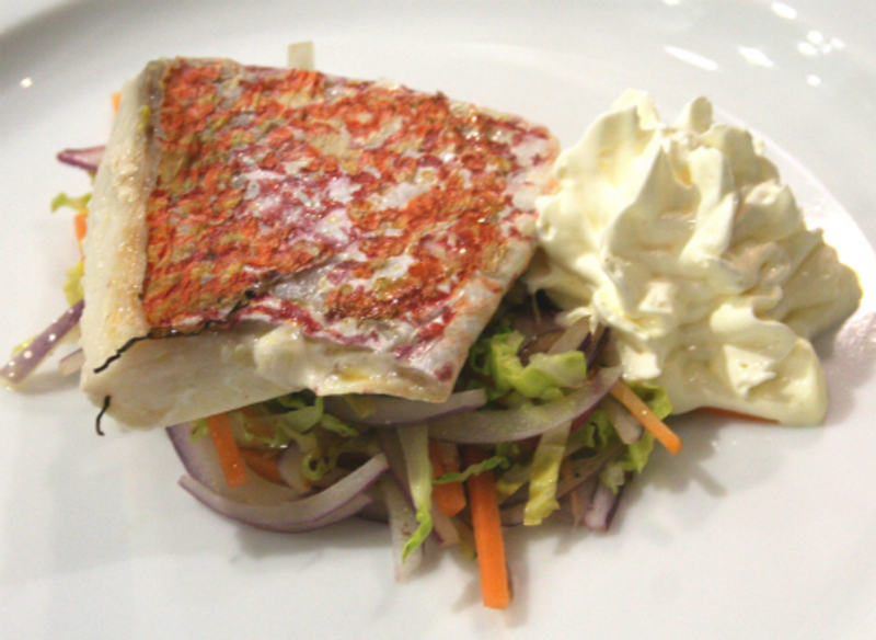 Sous Vide Red Snapper on a bed of Savoy cabbage stir fry with hollandaise and lime foam