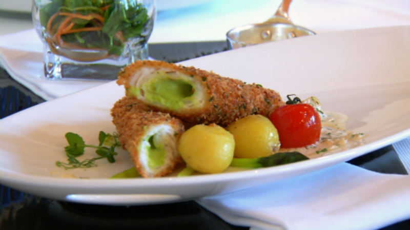 Breaded lemon sole stuffed with Philadelphia, pea & mint puree , spring vegetables and a Philadelphia clam sauce