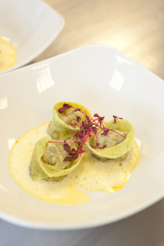 Portabella mushroom tortellini, saffron and garlic foam, with red micro salad