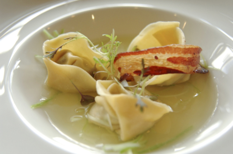 Tortellini of Anglesey Mussels with Consomme with Pancetta Crisp and Leeks