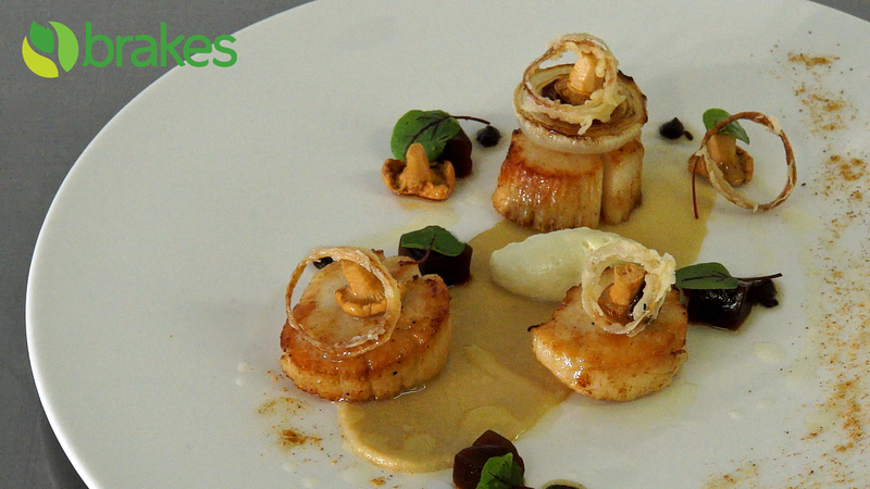 Pan Fried Scallops with Fermented Black Garlic, Shallot Mousse & Lobster Bisque Jelly by Richard Phillips