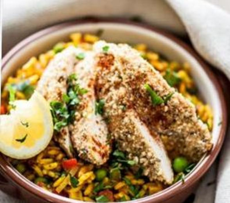 Spanish Chicken Paella with a MAGGI Southern Fried Crunchy Bake sevred with long grain rice