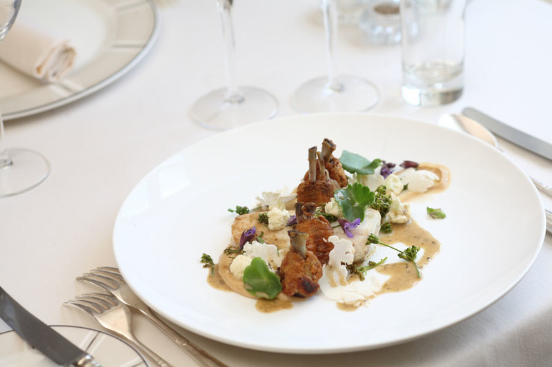 Fresh roast plaice & confit chicken wings with caramelised cauliflower & Alexander buds.