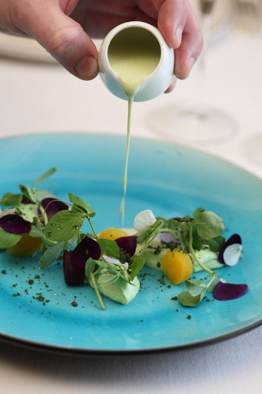 Pea panna cotta and lovage soup with salt baked beetroot, pea shoots & pansies