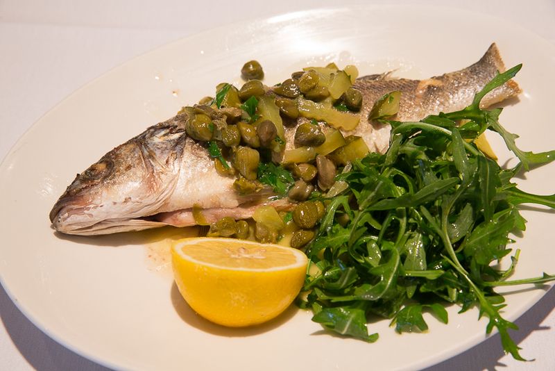 Whole Anglesey Seabass, with a parsley, caper and gherkin butter sauce