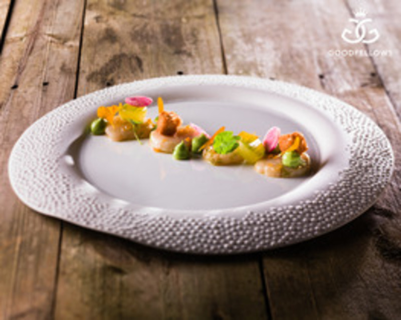 Marinated scallop avocado radish and pigs head croquettes by Adam Smith
