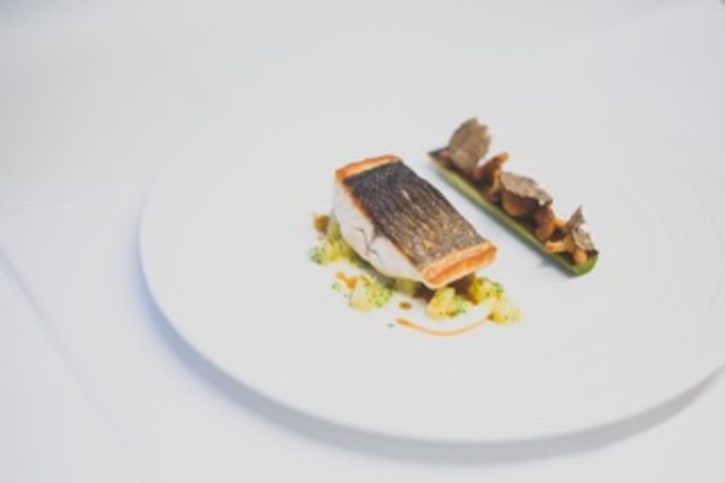 Line caught sea bass, potato risotto, charred leek, girolles and Wiltshire truffle