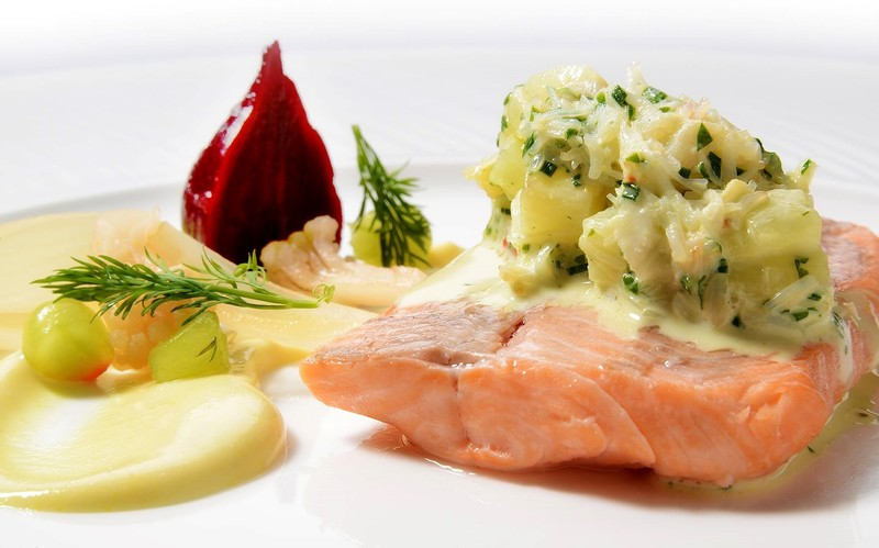 Poached sea trout with crab and potato salad