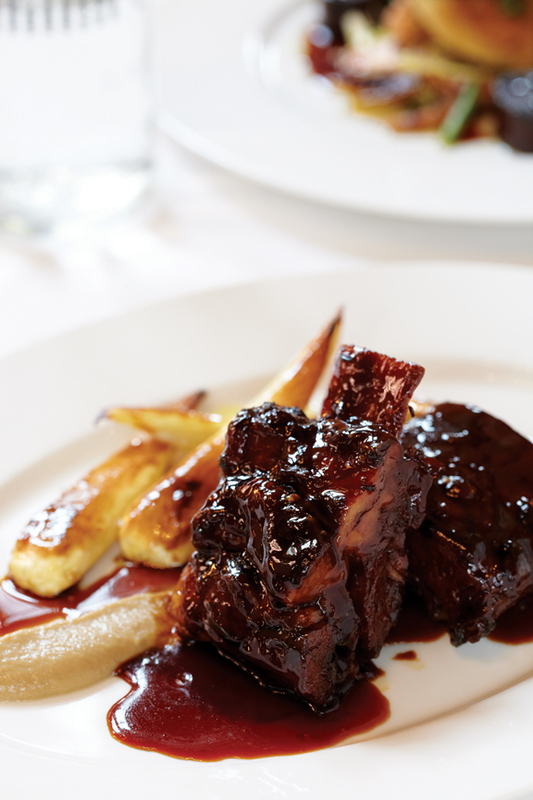 Slow-cooked short-rib of beef with shallot purée, honey-roast parsnips and hermitage wine sauce