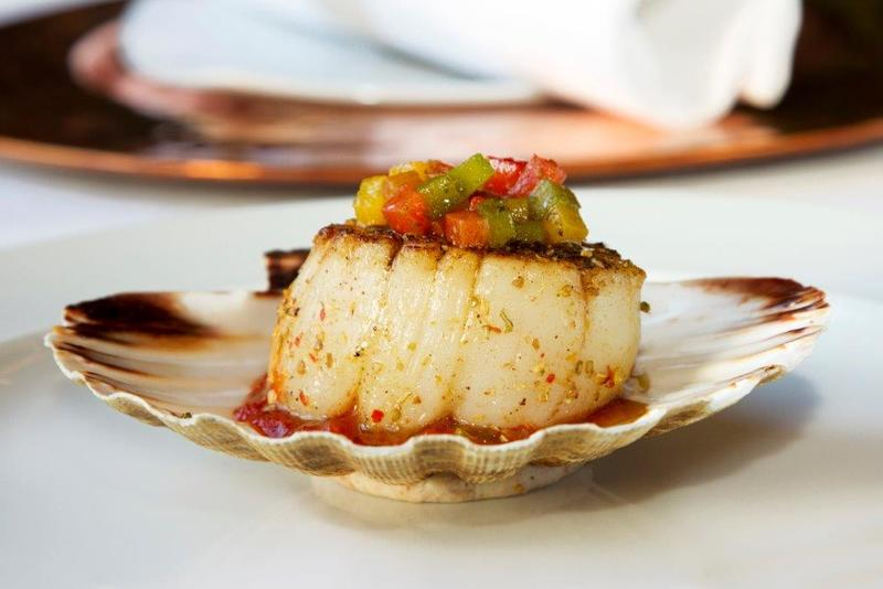 Grilled scallops with tomato chutney and roasted peppers
