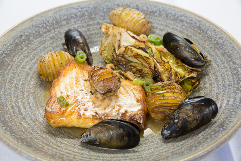 Brill Fillet, Chargrilled Sweetheart Cabbage, Hasselback Potatoes, Smoked Mussel, Shrimp and Cider Gravy