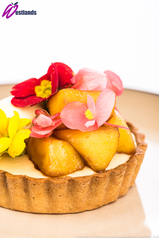 Toffee apple tart with clotted cream, Westlands apple blossom and primula flowers