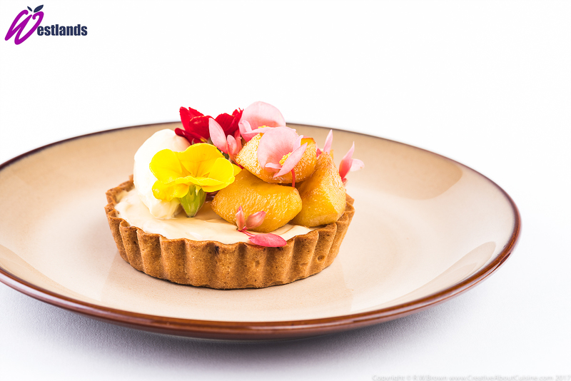 Toffee apple tart with clotted cream, Westlands apple blossom and primula flowers - 1