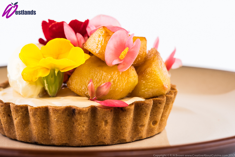 Toffee apple tart with clotted cream, Westlands apple blossom and primula flowers - 2