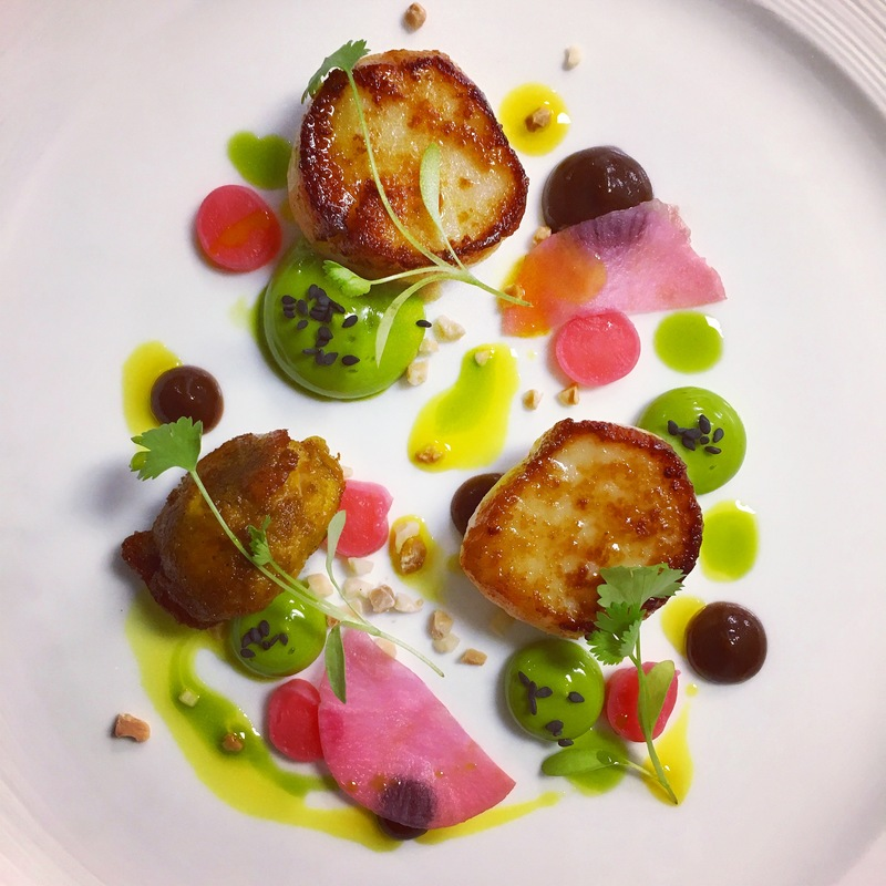 Seared scallops, pickled daikon, prune purée, herb mayonnaise and curried chicken oyster