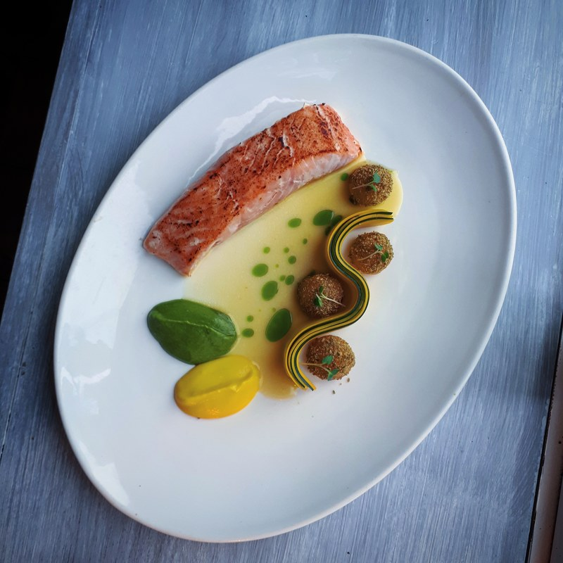 Torched 40° irish salmon, fennel crusted potato, courgette, lemon butter emulsion, basil oil