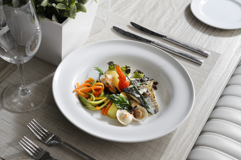 Sea bass with veggies and clams