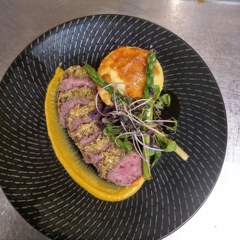 Herb crusted lamb backstrab, polenta gratin, pumpkin puree, asparagus, & rosemary jus