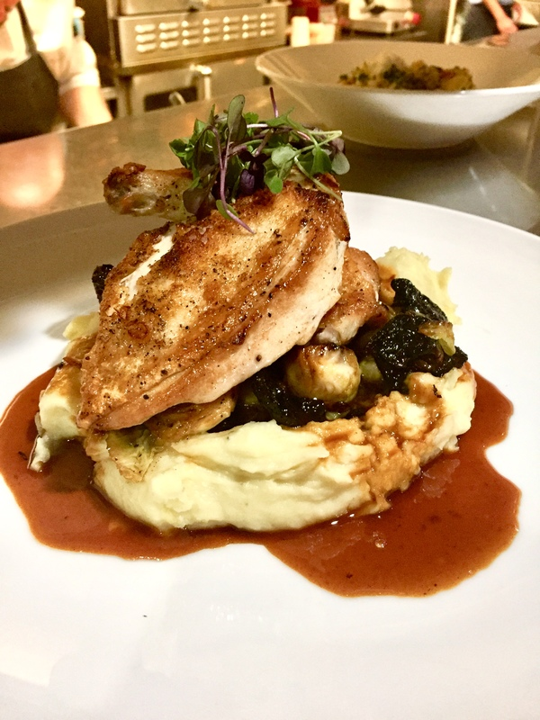 1/2 chicken pan seared served over herb whipped potatoes , roasted Brussels with drunken raisins finish with natural juice